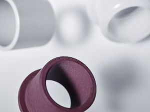 Plastic bushings overview: grey, transparent and burgundy bushings made from different materials